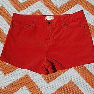 High waisted red corduroy shorts